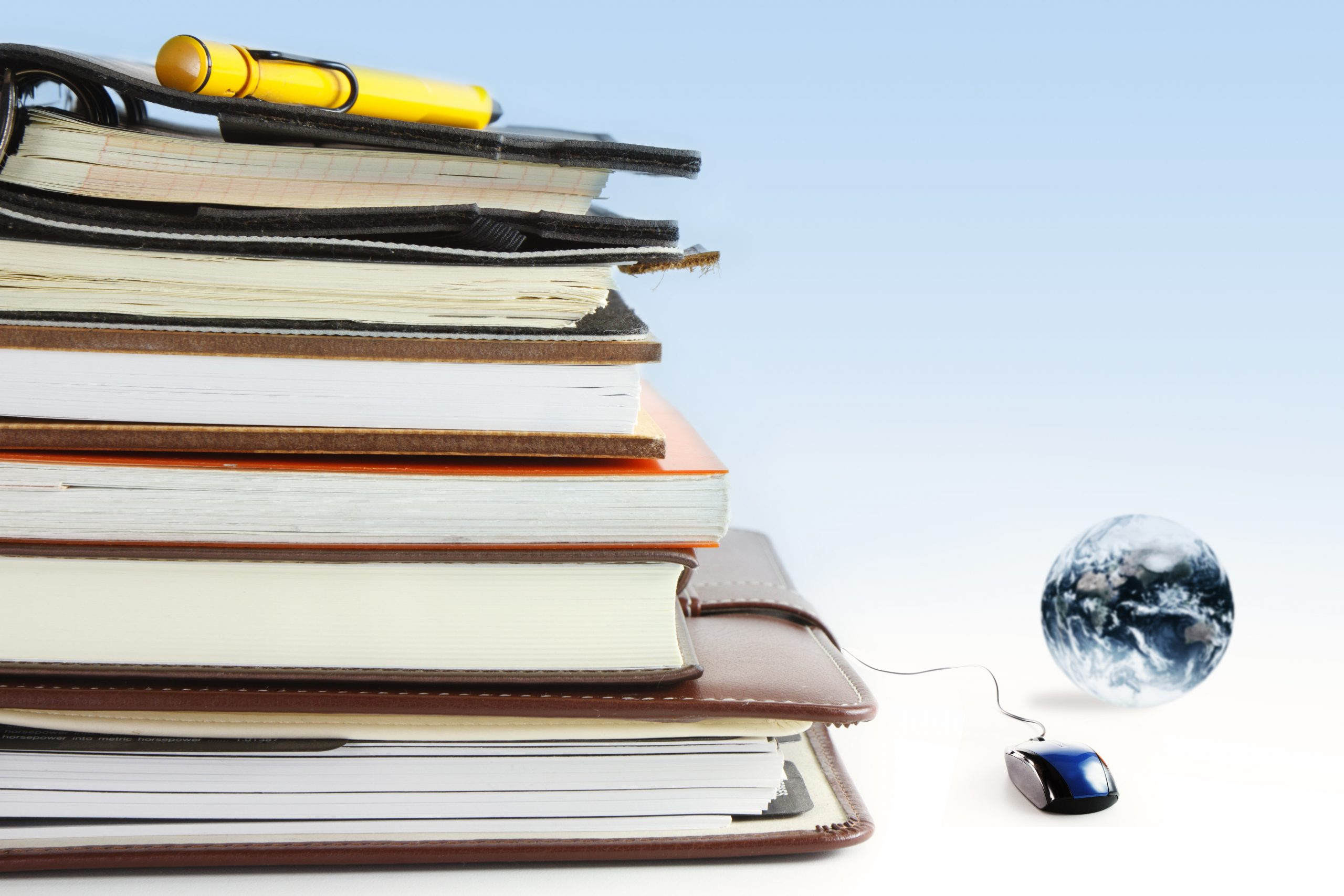 Books and mouse signifying online learning